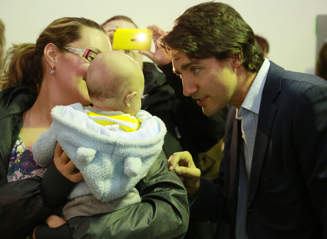 Justin Trudeau greets a baby Wednesday.