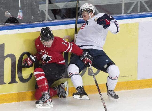 Team Canada defenceman Ryan Murphy collides with Team USA forward Blake Pietila.