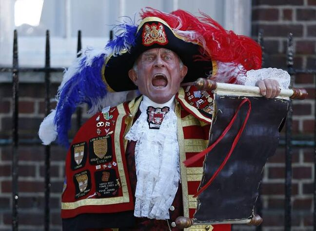 Tony Appleton, a town crier, announces the birth of the royal baby, outside St. Mary's Hospital exclusive Lindo Wing in London Monday. Palace officials say Prince William's wife Kate has given birth to a baby boy. The baby was born at 4:24 p.m. and weighs 8 pounds 6 ounces. The infant will become third in line for the British throne after Prince Charles and William.