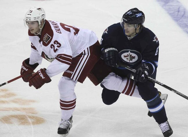 Winnipeg Jets' Michael Frolik (67) and Phoenix Coyotes' Oliver Ekman-Larsson (23) collide during the second-period of Thursday's game.