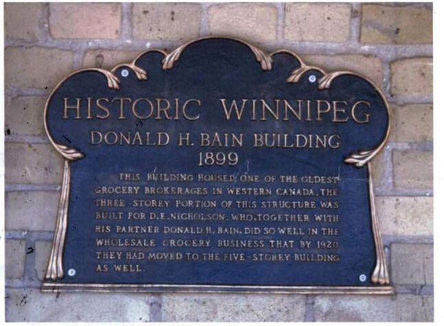 The 'Historic Winnipeg' plaque was mounted outside of the building at 115 Bannatyne Avenue.