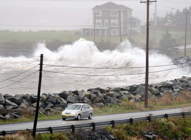 Waves hit the shore in Cow Bay, N.S. near Halifax on Tuesday. The Atlantic region was mainly spared from the wrath of hurricane Sandy, but high winds and rain are expected to continue for the next day. (The Canadian Press / Andrew Vaughan)