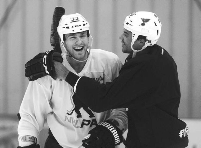 Nashville's Colin Wilson and St. Louis Blue Ryan Reaves work on their clutching and grabbing Friday at the MTS Iceplex.