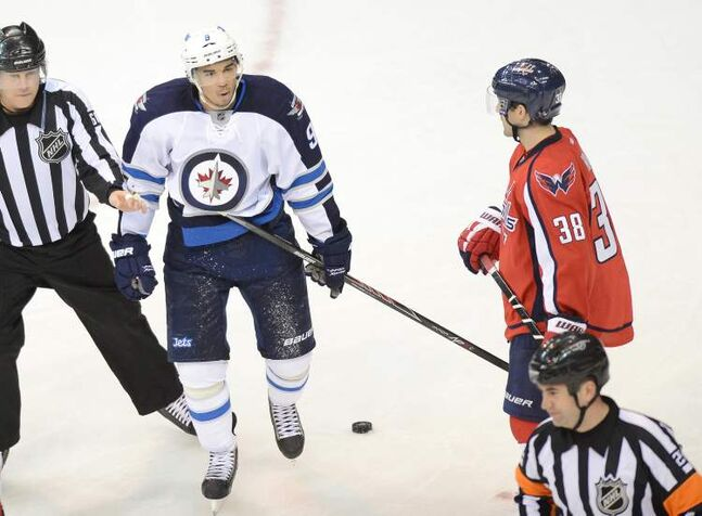 Winnipeg Jets left-winger Evander Kane questions referee Marc Joannette (25) after getting called for an elbowing penalty in the third period.
