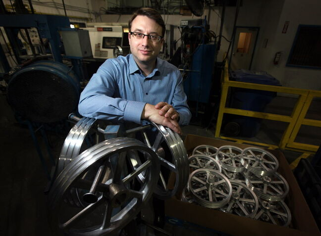 Custom Castings Ltd. president Mark Striepe poses at the company's factory, which creates aluminum castings used by manufacturers to make parts.