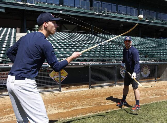 Goldeyes relief pitcher Chris Kissock (left) also has some hockey skills.