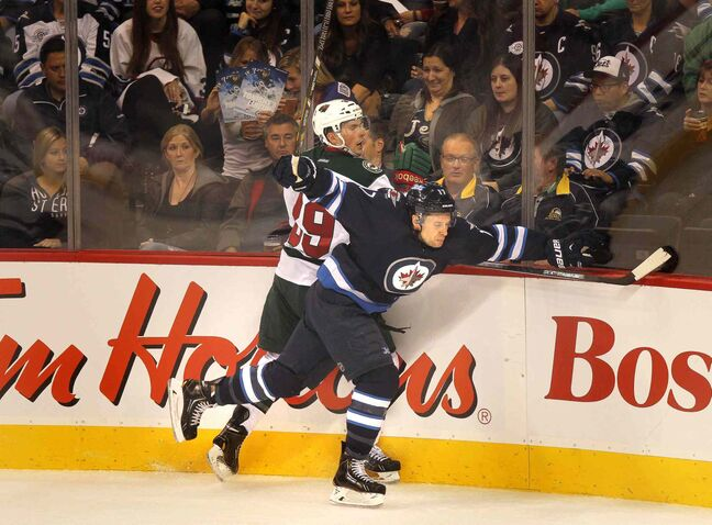 Nate Prosser and James Wright collide along the boards in the first period.