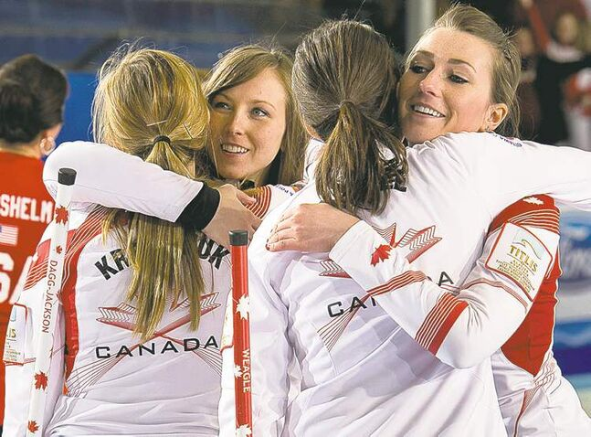 Canada's Alison Kreviazuk (from left), Rachel Homan, Lisa Weagle and Emma  Miskew celebrate their 8-6 win over the U.S. for bronze in Riga, Latvia, Sunday.