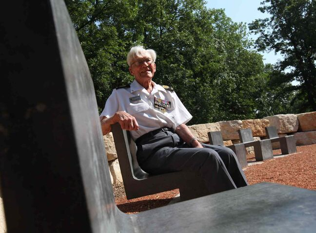 George Peterson, the last surviving member of the group of seven local Arden Avenue war veterans from the Battle of Hong Kong, sits in one of the seven chairs of honour at the new Jules Mager Park in St. Vital where a special ribbon cutting ceremony was held Saturday morning.