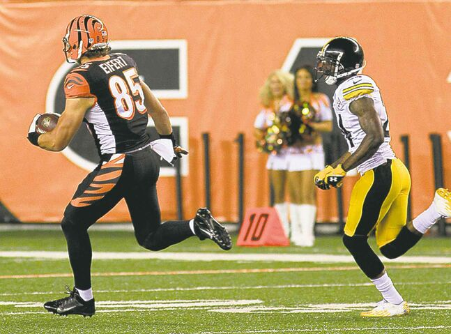 Bengals' Tyler Eifert romps for a 61-yard gain Monday.
