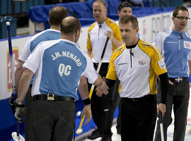 Manitoba skip Jeff Stoughton,right, shakes hands with Quebec skip Jean-Michel Menard at the Tim Hortons Brier in Kamloops, B.C. on Tuesday, March 4, 2014.