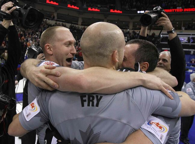 Skip Brad Jacobs (left) and teammates celebrate after defeating the John Morris rink.