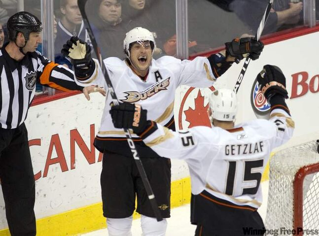 Anaheim's Teemu Selanne (left) celebrates with Ryan Getzlaf after scoring against the Vancouver Canucks. Last season, at age 40, Selanne had 80 points.
