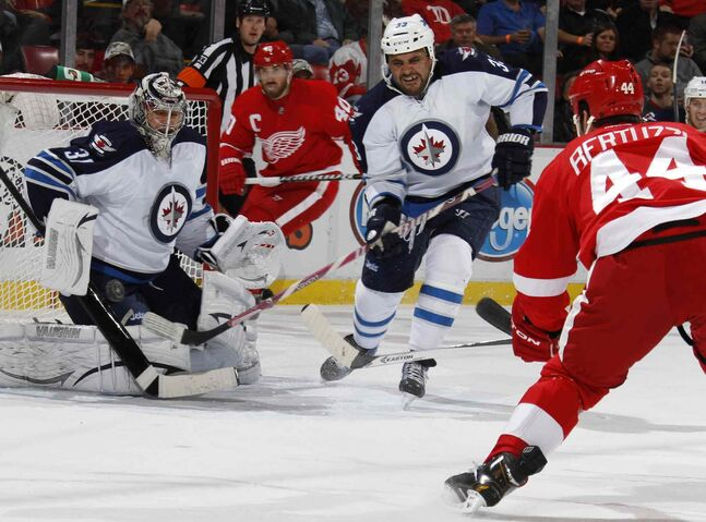 Detroit Red Wings forward Todd Bertuzzi fires a shot at Winnipeg Jets goalie Ondrej Pavelec in the first period.