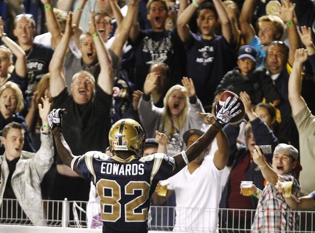 Winnipeg Blue Bombers' Terrence Edwards celebrates after scoring a TD during the second half of CFL action in Winnipeg Friday, August 26th, 2011. THE CANADIAN PRESS/Trevor Hagan