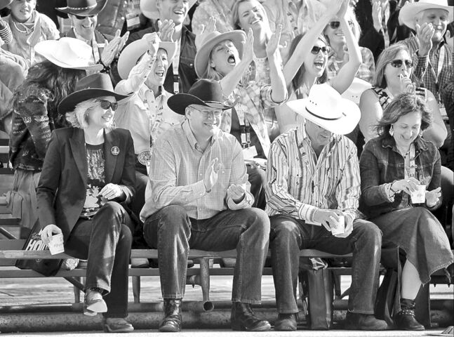 Prime Minister Stephen Harper, at the Stampede with wife Laureen, speaks to Conservatives in Calgary today.