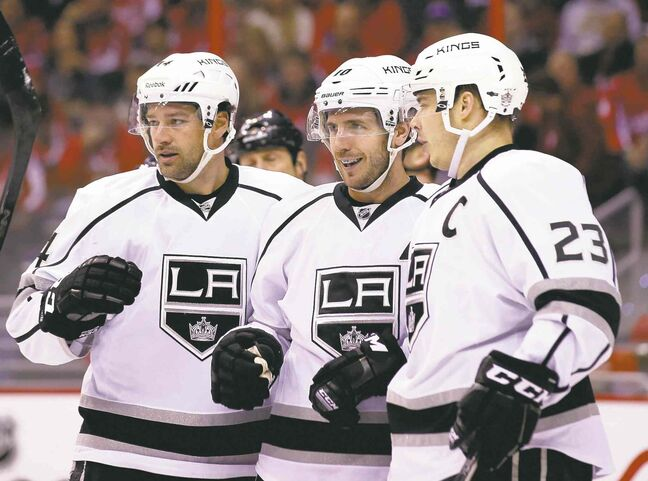 Mike Richards (centre) says he will work harder in the off-season in an effort to rebound in the next NHL campaign.