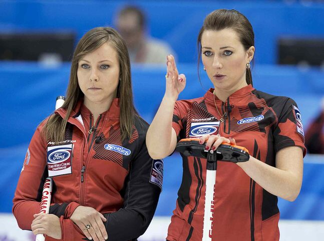 Canada skip Rachel Homan, left, and third Emma Miskew talk over a shot as they play Czech Republic at the Ford World Women's Curling Championships in Saint John, N.B. on Sunday, March 16, 2014.