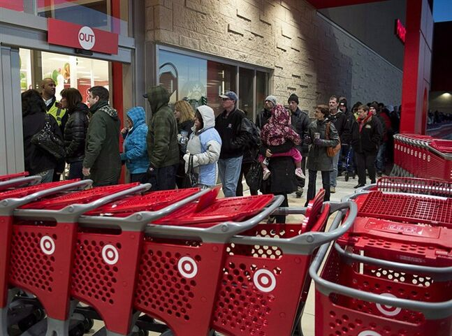Shoppers enter the Target store in Dartmouth, N.S. on Friday, Nov. 29, 2013. Black Friday, the most important shopping day of the year in the United States, is having an impact on Canadian sales as retailers work to keep consumers home, north of the border. THE CANADIAN PRESS/Andrew Vaughan