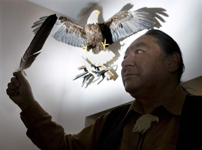 May 20, 2008: Former politician and honorary Cree Chief Elijah Harper holds up one of two Eagle feathers he held during Meech Lake proceedings, in Ottawa.