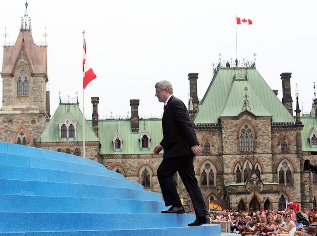 Prime Minister Stephen Harper makes his way onto the stage at the Canada Day celebrations on Parliament Hill in Ottawa.