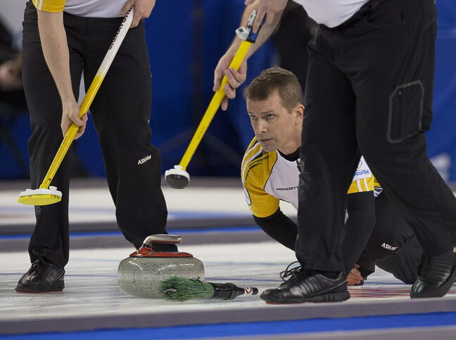 Manitoba skip Jeff Stoughton follows a rock as they take on Quebec in playoff action at the Tim Hortons Brier in Kamloops, B.C. on Saturday, March 8.