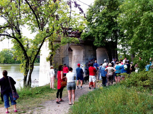 Walkers congregate near the Bergen Cut-Off Bridge during a North East Winnipeg Historical Society tour hosted by Jim Smith on Sept. 8.