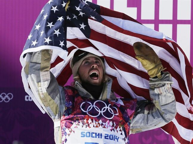 United States' Sage Kotsenburg celebrates after winning the men's snowboard slopestyle final at the Rosa Khutor Extreme Park, at the 2014 Winter Olympics, Saturday, Feb. 8, 2014, in Krasnaya Polyana, Russia. (AP Photo/Andy Wong)