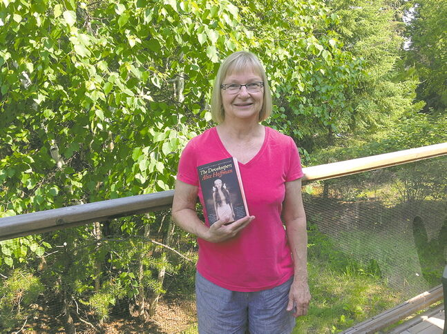 Carolyn Campbell poses with The Dovekeepers, a novel be Alice Hoffman she says is her favourite summer read..