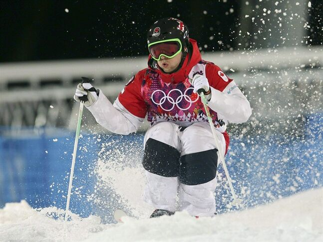 Canada's Alex Bilodeau makes his last run in the men's moguls final at the 2014 Winter Olympics, Monday, Feb. 10, 2014, in Krasnaya Polyana, Russia. THE CANADIAN PRESS/AP/Sergei Grits