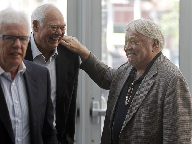 Ulf Nilsson (left), Ab McDonald and Bobby Hull (right) arrive at the funeral for Don Baizley at the MTS Centre Wednesday.