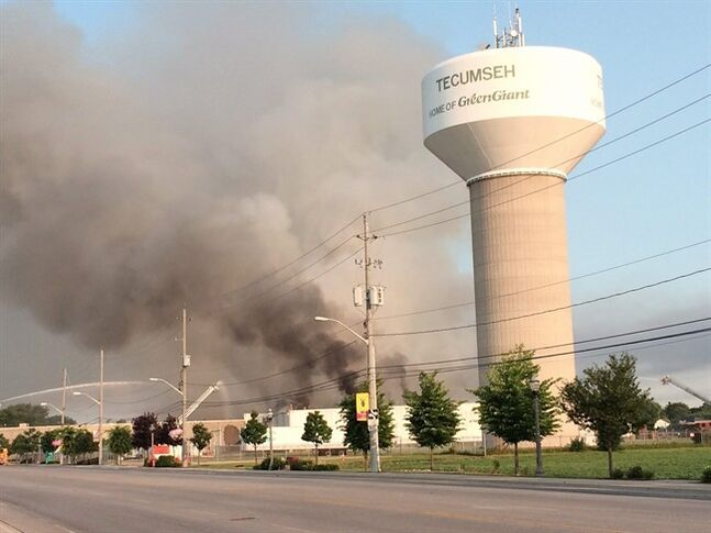 Firefighters try to put out a fire at the Bonduelle food-processing plant in Tecumseh, Ont. on Friday, July 18, 2014. THE CANADIAN PRESS/AP, Detroit Free Press, Robert Allen