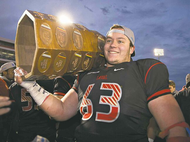 The Bombers brought in Laval OL Pierre Lavertu, holding the Dunsmore Cup, for a personal workout today.