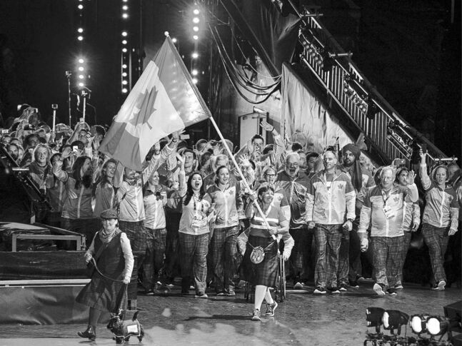 Andrew Vaughan / THE CANADIAN PRESS FILESFlag-bearer Susan Nattrass leads the Canadian team as they arrive at the Commonwealth Games opening ceremony in Celtic Park in Glasgow on Wednesday.