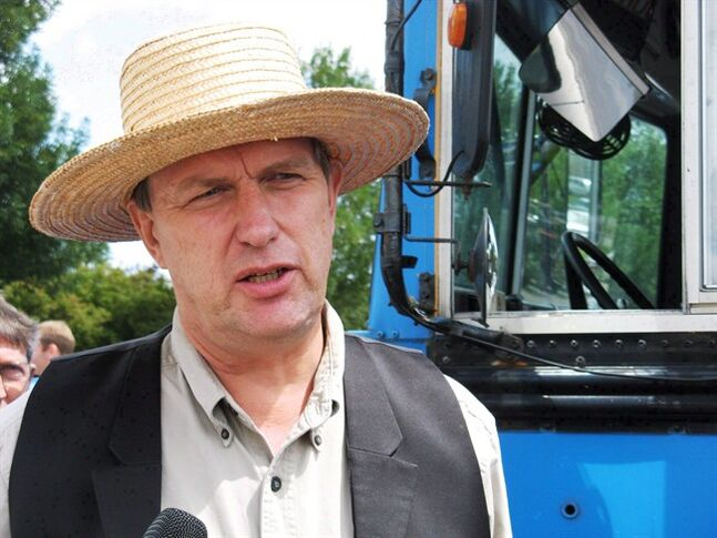 Farmer Michael Schmidt talks to reporters on Thursday July 31, 2008 outside court in Newmarket, Ont. The Supreme Court of Canada will not hear an appeal from Schmidt who has long championed the right to sell and drink unpasteurized milk. THE CANADIAN PRESS/Colin Perkel