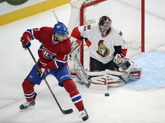 Ottawa Senators' Craig Anderson makes a save on Montreal Canadiens' René Bourque during the first period.