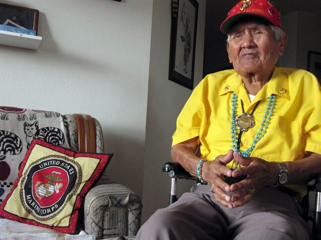 FILE - This Nov. 29, 2009, file photo, shows Chester Nez talking about his time as a Navajo Code Talker in World War II at his home in Albuquerque, N.M. Nez, the last of the 29 Navajos who developed an unbreakable code that helped win World War II, died Wednesday morning, June 4, 2014, of kidney failure at his home in Albuquerque. He was 93. (AP Photo/Felicia Fonseca, File)