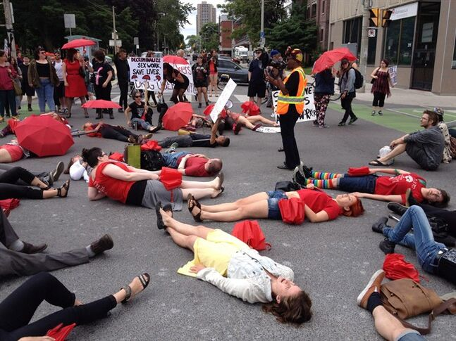 Demonstrators protest the Harper government's proposed prostitution legislation on a Toronto street Saturday, June 14, 2014. THE CANADIAN PRESS/William Campbell