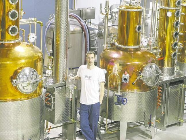 Tyler Schramm, co-owner of Pemberton Distillery Inc., shows off the equipment used to produce potato-based spirits.
