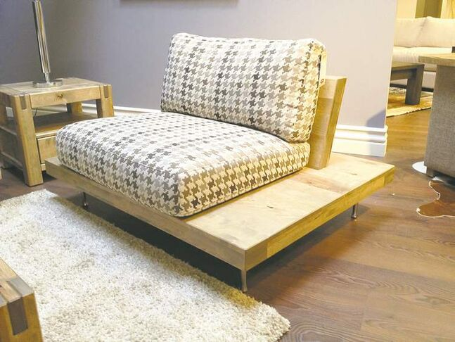 Sofa and end table built of recycled wood are new furniture items at Design Manitoba.