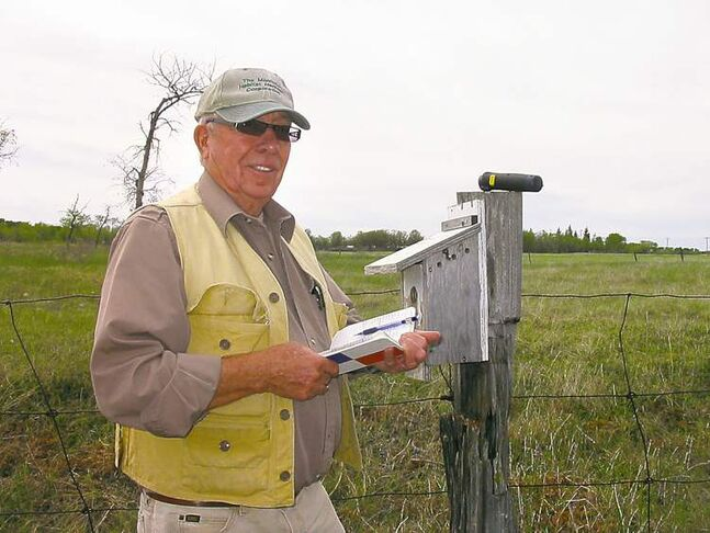 Herb Goulden, a Brandon Friends of Bluebirds member, records findings from one of his 45 bluebird boxes.