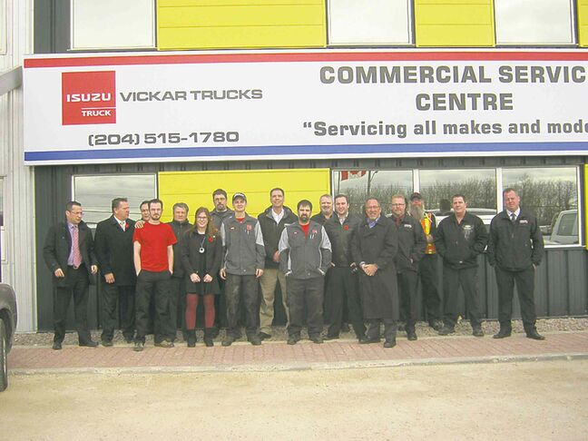 Vickar Commercial truck centre staff including western Canada sales, service and parts manager Don Mackie on extreme left and Isuzu Canada executive vice-president Joe Totaro fifth from the left.
