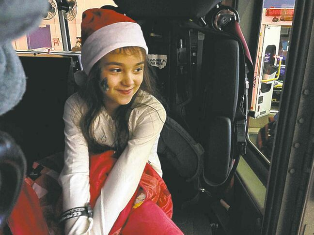 Nine-year-old Cheyenne Tanasychuk sits inside a fire truck  at the annual Salvation Army breakfast Saturday morning.