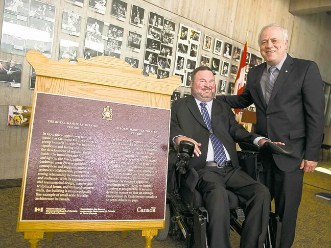 Conservative MP Steven Fletcher (left) and artistic director Steven Schipper pose with the plaque at Saturday's ceremony.