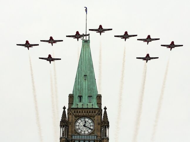 The Snowbirds fly over the Peace Tower at the Canada Day celebrations on Parliament Hill, in Ottawa.