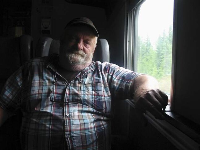 Rick Bello, a climatologist at York University, travels coach in a Via Rail train leaving Churchill. Bello has been conducting research in the area for over 30 years.