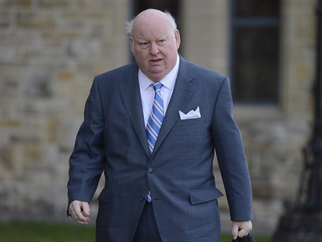 Sen. Mike Duffy arrives to the Senate on Parliament Hill in Ottawa, Monday, October 28, 2013. THE CANADIAN PRESS/Adrian Wyld