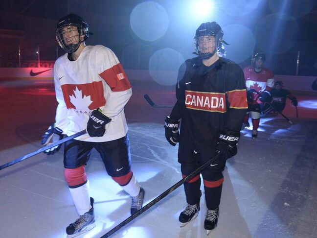 Youth players model the new Canadian Olympic team hockey jerseys as they are unveiled in Toronto.