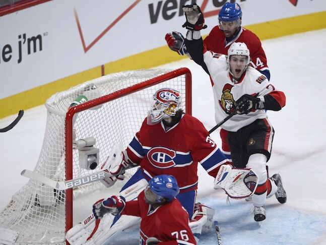 Ottawa Senators' Kyle Turris celebrates his goal on Montreal Canadiens goalie Peter Budaj as Canadiens' Tomas Plekanec (14) and P.K. Subban (76) look on. The goal was reviewed, as Turris was in the crease, but the call on the ice (a goal) stood, putting the Senators up 3-1.