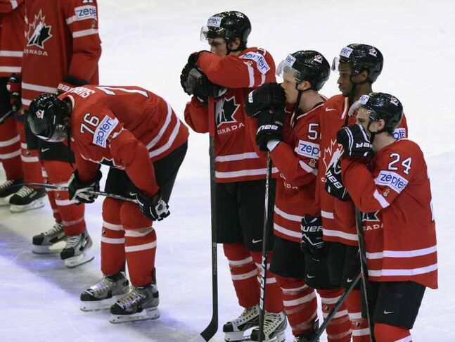 Canada players hang their heads after losing to Sweden 3-2 in a shootout on Thursday.